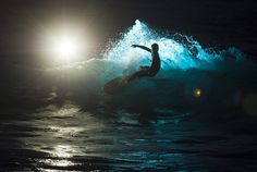 Night surfing....this would totally freak me out, but be exhilarating at the same time!!!!