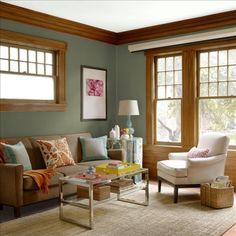 green living room with oak sash windows