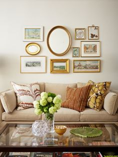 I like this picture arrangement. One big oval in middle, little oval on side, rectangle frames surrounding. All gold and white. // goodbonegreatpieces
