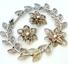 Lovely antique French filigree silver demi parure bracelet and earrings. $47.00