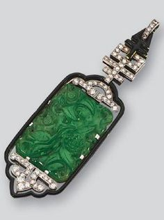 Jadeite, enamel and diamond pendant, Lacloche, 1920s. The openwork pendant of geometrical design decorated at the centre with a jadeite plaque sculpted in a floral pattern, highlighted by single- and circular-cut diamonds and a black enamel border, mounted in platinum.
