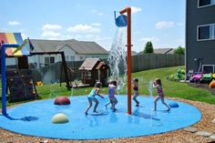 Backyard splash pad! We installed this fun spray park for this family in Michigan, It is a 20' circle with a Single Bucket Dump, a Flower Shower, 3 different size Bumps, 16 below ground nozzles and 325 sq ft of MSP Safer Surface. Best backyard around for children.