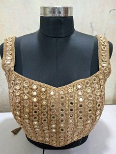 A hand made mirrorwork blouse to be worn with lehenga skirt, saree, or trousers. Saree Blouse Patterns, Saree Blouse Designs, Golden Blouse Designs, Mirror Work Saree Blouse, Lehenga Skirt, Embroidery Neck Designs, Maggam Works, Stylish Blouse Design, Lehenga Designs