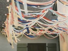 Or leave the walls how they are, screw some sturdy twine or dowels across the ceiling, and use bright strips of fabric, crepe paper, ribbon, twinkle lights, etc to make a really fancy roof. It'll make the room feel cozier, especially if the ceiling is painted the same color as the walls, and you can switch it later. From: streamers + twinkle lights  labor day outdoor movie bash