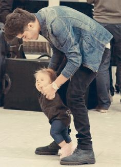 OH MY GOD!! HE IS GOOD WITH BABIES TOO!!! LIKE WHAT THE HECK!! HE IS JUST SO AMAZING, OH MY GOD!!! THAT IS LITERALLY SO SWEET, HELPING THAT BABY WALK!! I AM MELTING!! HOW IS IT POSSIBLE FOR ONE HUMAN BEING TO BE BLESSED WITH A GORGEOUS VOICE, THE MOST SEXY BODY EVER, AND BE GOOD WITH KIDS?? IF YOU COULDN'T TELL I AM DYING!!