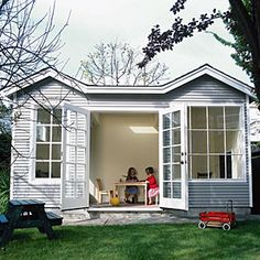 Pigeon coop transforms into a playhouse  by adding a large window, a skylight, and a pair of French doors and repairing the concrete floors. The versatile space may later be used as a studio, office, or guest house. (DESIGN:  Geoffrey Holton and Associates, Oakland via Sunset Magazine)