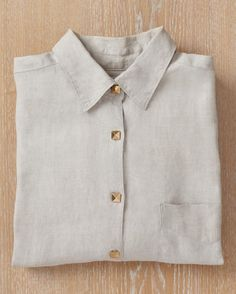 Shirt  Try a subtle accent by covering shirt buttons with pyramid studs.  By simply placing the studs over top of the existing buttons, they can be added and removed without affecting the original shirt.