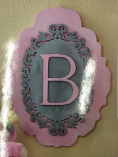 Pretty and inexpensive decoration for a baby's room. Wooden frames from Michaels.