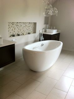 BuildDirect – Porcelain Tile - Element Series – Bone - Bathroom View. $1.70/ sf
