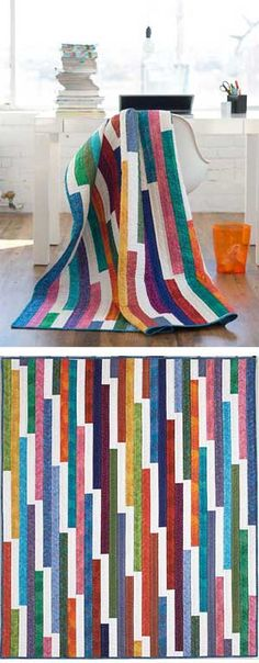 """BRIGHT IDEA QUILT 62x75 - 2 1/2 inchxWOF strips with about 13"""" white/light strips sewn in between each one."""