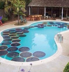 Hula-hoop Pool Warmers                  This is an ingenious idea if you have a pool; nothing's worse than freezing cold water. Instead of spending money on an expensive solar cover, just get some hula-hoops, fill them with black plastic (you can melt it around the edges), and put them in your pool. The black will absorb heat, which will transfer to your pool, making it a warm get-away for your whole family!