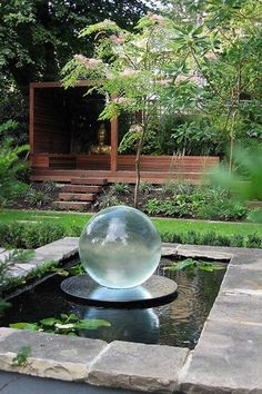 Landscape/Yard with Pond, Glass Sphere Water Feature, Gazebo, exterior stone floors, Raised beds, Pathway, Fence