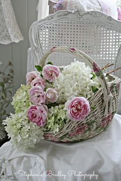 """Darcy chair with a basket of garden hydrangeas and David Austin roses from my garden."""