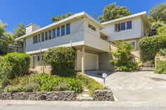 Inviting 2-story Mid-Century home in the heart of Greenbrae in a gracious tree lined neighborhood. Features 3 bedrooms & 2 baths on the same level, formal dining room, private den, wood-burning...