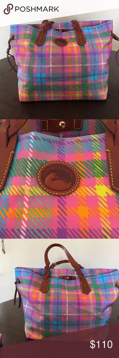 Shoulder bag This multi colored bag is perfect for shopping and maybe a beach trip. Could be a laptop bag or for school books.has no tags but never used. Comes with a shoulder strap Dooney & Bourke Bags Shoulder Bags
