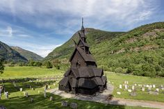 The stave church of Borgund, for me the most impressive I've seen in Norway. In some of my previous stave church pictures I've wrote something about the tarring of the church. Here one can see an almost black facade. A few years later this will change to a rather wooden color (like you can see on the one from Lom). This church is an really bizarre black building standing on a wonderful green meadow, something I'd only expect to exist in a fairy tale. See the reference for the whole…