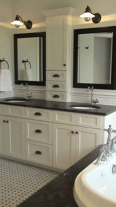 Though I don't love this style, I like the way the double vanity runs the whole length of the bathroom and the storage between the two sinks.
