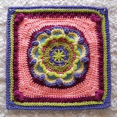 KISS2 is a floral crochet square designed as a component for a blanket and has sprung to life for the May square for BAMCAL 2015s.