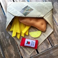 READY TO POST!!!!!  Fish and chips felt play food  pack includes: 1 battered fish 8 chips 1 slice of lemon 1 sachet of tomato sauce all wrapped up classic old-fashioned way, in the newspaper  All my food is handmade, non toxic, combination of machine and hand-stitching and embroidery, few pieces are secured with fabric glue. Your children will simply love it!  Lot of care is taken creating the felt food as safe as possible for children, but as with all the toys, there are possible small…