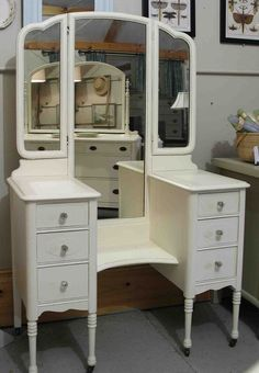 vintage vanity dresser with mirror. drop well vanity used as a dressing table  painted Cottage White with glass knobs and tri fold mirror The two side mirrors in for different angles Vintage 1940s Vanity w Large Round Mirror Four Drawers