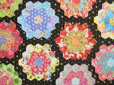 What a great, modern, grandmother's flower garden. Makes me want to do hexagons... almost...