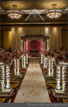 Elegant Indian wedding ceremony decor. Love the pillars! #arisingimages…