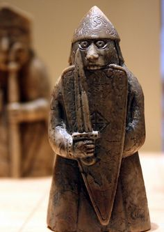 The Lewis Chessmen at the museum of Scotland, Edinburgh - a bezerker biting his shield.