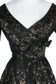 d8721ddfe3b  1950s  Dior  black and  gold brocatelle  cocktail  dress with  hourglass  shape