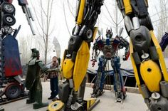 Transformers----------Industrious (and perhaps slightly bored?) farmers in rural China have built their own versions of the iconic Transformer robots out of car parts.