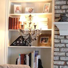 Sconce on built in bookshelf
