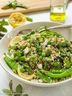 Spring Farro Salad with Feta, Lemon, and Mint is a hearty salad packed with spring produce and the freshness of lemon and mint. It makes a perfect side dish or lunch! @Flavor the Moments #spring #farro #salad #asparagus #peas #favabeans #lemon #feta