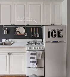 Simple Ikea Racks Were Installed For Additional Storage In The Pint Sized  Kitchen. A Vintage Inspired Decal Is A Playful Touch On The Freezer Door.