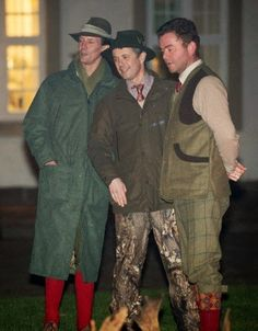 (L) Prince Joachim and Crown Prince Frederik (C) attends the annual traditional game parade with flaming torch at Fredensborg Castle on 27.11.2014