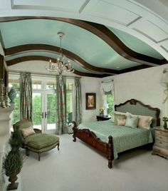 Thought grey was cold?  Not so when coordinated with the warmth of mahogany and restful blue greens enveloping the bed and crowning the room.  The rich mahogany ceiling beams are an accent to consider in that search for architectural interest and look just fine with white moldings around the windows and doors.