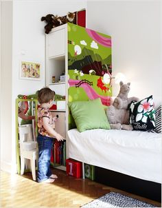 Book case used as a bed headboard with storage