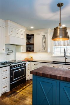 After purchasing their forever home, these homeowners contacted Blackline Renovations with a desire to renovate their outdated kitchen, as well as the dining room, hallway, hall bath, and front entry. With their sights set on a La Cornue CornuFé range, they turned to Blackline for their expertise in designing and building a kitchen that would complement their new range and fit their desired target budget. La Cornue, Building A Kitchen, Front Entry, Remodels, Kitchen Remodel, Target, Dining Room, Luxury, Fit