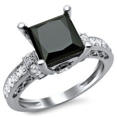 This gorgeous 14-karat white gold engagement ring features a soft satin finish. A huge princess-cut black diamond adds sparkle to this solitaire ring.