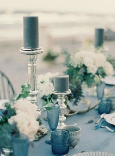 Blue Wedding Flowers How To Create A Beautiful Dusty Blue Wedding - Dusty blue is a timeless shade that is elegant and is the perfect 'something blue' for your day. Take a look at how you can create a dusty blue wedding! Table Decoration Wedding, Blue Wedding Decorations, Blue Wedding Centerpieces, Spring Decorations, Stage Decorations, Candle Centerpieces, Centerpiece Ideas, Blue Table Settings, Summer Wedding Colors
