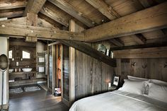 Chalet style attic master bedroom.
