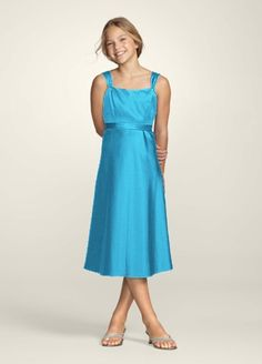 The perfect choice for a junior bridesmaid, this classic style is youthful yet elegant.  Wide-strap tank bodice is simple yet chic.  Waist is accented with removable tie-backsashfor endless personlization options.  Tea-length skirt is flattering and age-appropriate.  This style features an adjustable fit for added flexibility and comfort with fewer alterations.  Fully lined. Back zip. Imported polyester. Dry clean only.