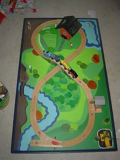 Re-painted train table@Stacey Wagner- Doesn't somebody at your house like trains?