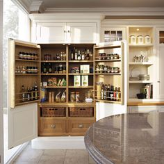 Bespoke pantries by Tom Howley make finding kitchen essentials a breeze. With carefully considered details like bespoke internal storage and a range of door options, we can create a pantry that's perfect for your home.