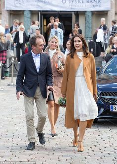 Queen of style: Mary's off-white and gold thread dress costs AUD$681 online, and she acces...