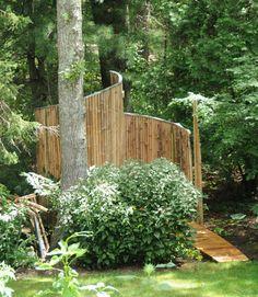 Another spiral outdoor shower. Love the little walkway leading to the shower. :)