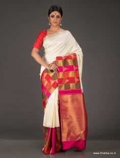 A paragon of Kanchipuram Silk Sarees, Indumukhi Resplendent White with Colorful Border and Pallu Pure Kanchipuram Silk Saree looks exalted in purity of white contrasted with richness of colors and patterns. A creation that surpasses the imagination of modern designers, the checks and temple design and the 100% pure zari work on the pallu and border looks alluring.