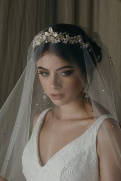A floral wedding headpiece that ticks all the right boxes - - Flores is a floral wedding crown constructed from a dreamy palette of soft ivory, pale gold and silver tones. We love its decadent details and modern style. Wedding Headband, Gold Wedding Crowns, Bridal Hair Vine, Bridal Crown, Bridal Tiara, Wedding Veils, Bridal Headpieces, Wedding Jewelry, Headband Veil