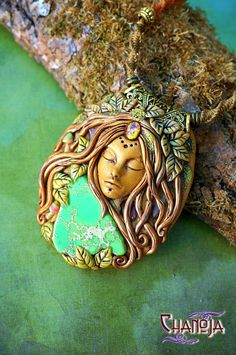 Autumn Goddess Pendant-mushroom jewelry fairy clay goddess art unique necklace by ChaNoJa.  Autumn Goddess Pendant mushroom jewelry fairy clay goddess art.  Listen to the divine clarity of your soul! This green and golden Autumn Goddess is indeed a breathtaking statement piece and eyecatcher. She is pure magic! All my creations are unique and exist only once. While creating them, I use my imagination, the warmth of my hands and I leave a bit of my soul in every piece.