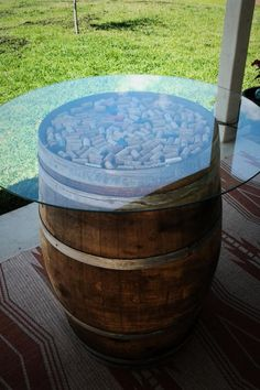 Wine Barrel Table With Glass Top Going To Put Flowers In Brown Beer Bottles  On Top