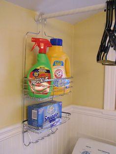 O si eres muy poco espacio de almacenamiento, colgar una barra de cortina de ducha por encima de la lavadora / secadora, y utilice un carrito de la ducha para almacenar su detergente.
