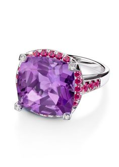 Couleur d'Amour ring by Mauboussin, white gold, amethyst central stone with diamonds and paved rubies.